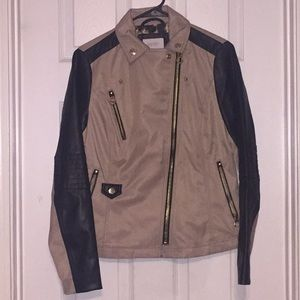 Leather jacket with cheetah print interior